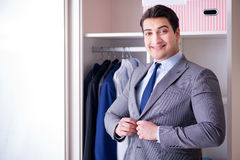 The young man businessman getting dressed for work Stock Photo