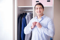 The young man businessman getting dressed for work Stock Image
