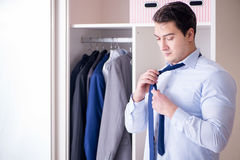 The young man businessman getting dressed for work Stock Photography