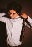 Young man businessman with glasses takes off a tie. Royalty Free Stock Photos