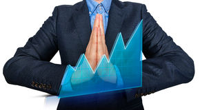 Young Man Businessman praying and Wishing Hard. Royalty Free Stock Photo