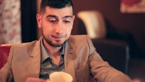 Young man businessman tired from work. In cafe stock video footage
