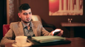 Young man businessman tired from work. In cafe stock footage