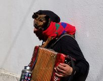 Busker With Small Dog And Accordion. Young man busking in Lisbon Portugal with his small dog and accordion Royalty Free Stock Image