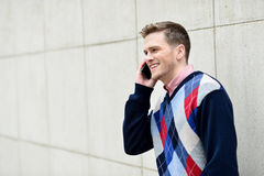 Young man busy in a phone conversation Royalty Free Stock Image