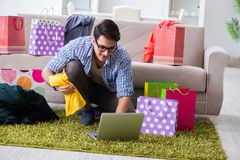The young man buying clothing online and running blog Royalty Free Stock Photography