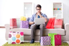 The young man buying clothing online and running blog Stock Images