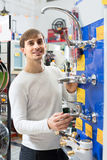 Young man buying new water in supermarket Royalty Free Stock Image