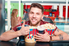 Young man buying popcorn and coke Stock Photography