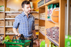 Young man buying some food at a store Royalty Free Stock Photography