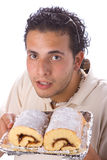 Young man and cake 2 Stock Photos