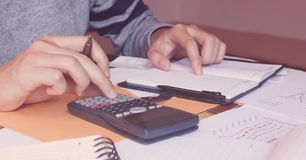 Young man calculate about cost and doing finance in home. Royalty Free Stock Photography