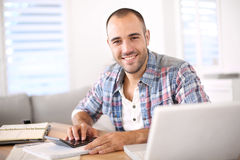 Young man calculating budget at home Stock Photography