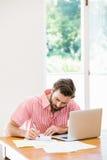 Young man calculating his bills Stock Photos