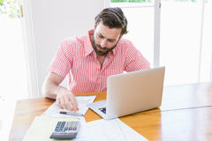 Young man calculating his bills Stock Images