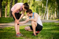 Young man with calf Injury Royalty Free Stock Image