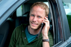 Young man is calling in the car Royalty Free Stock Photo