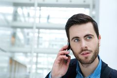 Young man calling by cellphone. Close up portrait of an attractive young man calling by cellphone Royalty Free Stock Image