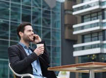 Young man calling by cellphone Royalty Free Stock Photography