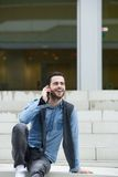 Young man calling with cellphone Royalty Free Stock Photography
