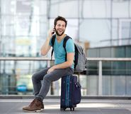 Young man calling by mobile phone at airport Royalty Free Stock Photography