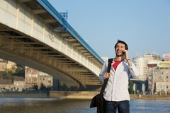 Young man calling by mobile phone outdoors Royalty Free Stock Image