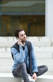 Young man calling by mobile phone Stock Image