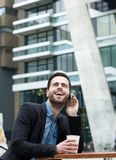 Young man calling with mobile phone Royalty Free Stock Photography