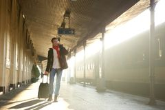 Young man calling by mobile phone at train station Stock Images