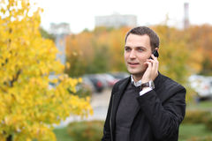 Young man calling by phone in the street Stock Photography