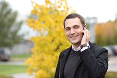 Young man calling by phone in the street Stock Photos
