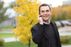 Young man calling by phone in the street Stock Photo