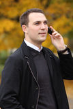 Young man calling by phone in the street Royalty Free Stock Image