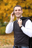 Young man calling by phone in the street Royalty Free Stock Photography