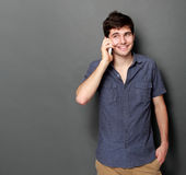 Young man calling by phone Stock Images