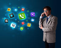 Young man calling by phone with various icons Stock Photo