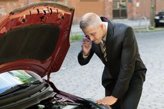 Young man calling technical car service Royalty Free Stock Photography