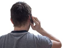 Young man is calling using smartphone. View from behind. Isolated on white background stock photos