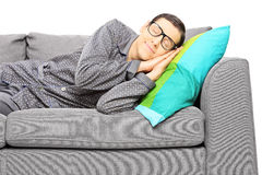 Young man calmly sleeping on a couch Stock Images
