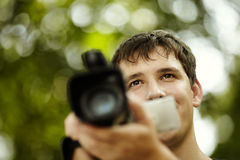 Young man with camcorder Royalty Free Stock Photography
