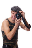 Young man with a camera. Smiling young man with a camera Royalty Free Stock Photography