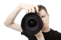 Young man with camera Royalty Free Stock Photo