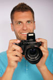 Young man with a camera Stock Photos
