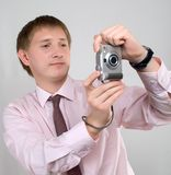 The young man with the camera Stock Photos
