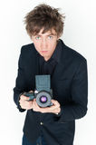 Young man with camera.  Royalty Free Stock Image