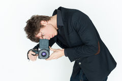 Young man with camera Stock Photos