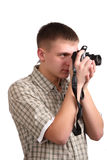 Young man with a camera. On a white background Royalty Free Stock Images