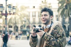 Young man with a camera Stock Images