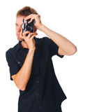 Young man with camera on white Stock Photos