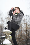 Young man with a camera at winter Stock Photography